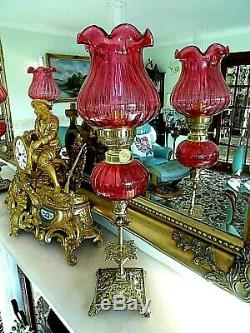 A Beautiful Pair Of Fine Quality Cranberry Victorian Style Peg Oil Lamps