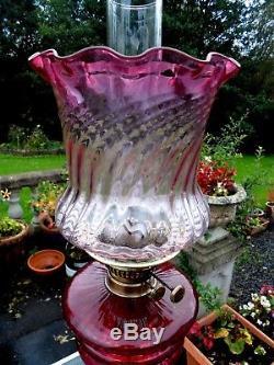 A Good Quality Ruby Victorian Corinthian Column Twin Duplex Table Oil Lamp