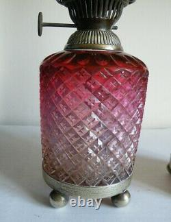 A Pair Of Victorian Cranberry Glass Table Oil Lamps