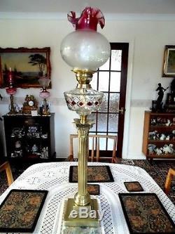 A Superb Victorian Ruby Diamond Cut Glass Corinthian Column Oil Lamp