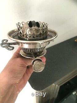 A antique Hinks no 1 silver plate oil lamp burner