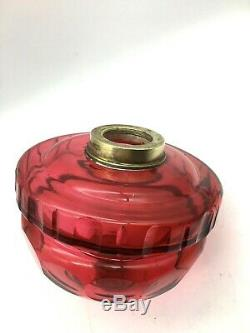 A antique large cranberry facet cut oil lamp font