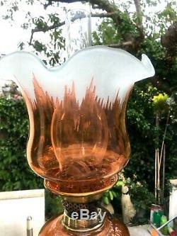 Antique burnt orange oil lamp metal and brass, orange tulip shade