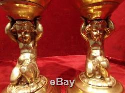 Pair cherub oil lamps