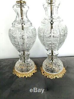 Pair of large antique cut glass table lamps with gilded brass fretwork bases