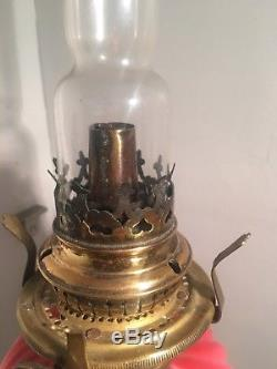 Pink wrythen moulded satin twist peg oil lamp brass base zimmerman & co