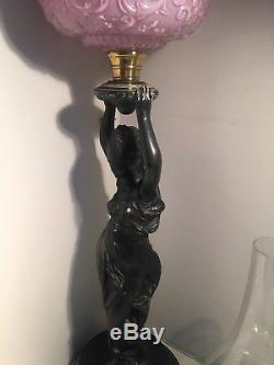 Victorian metal figural oil lamp with a embossed pink fount and funnel