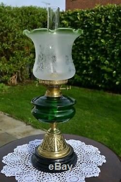 Victorian twin burner oil lamp. Bottle Green font no damage frosted shade etched